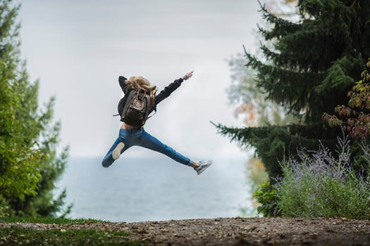 Woman jumping for joy in 2018